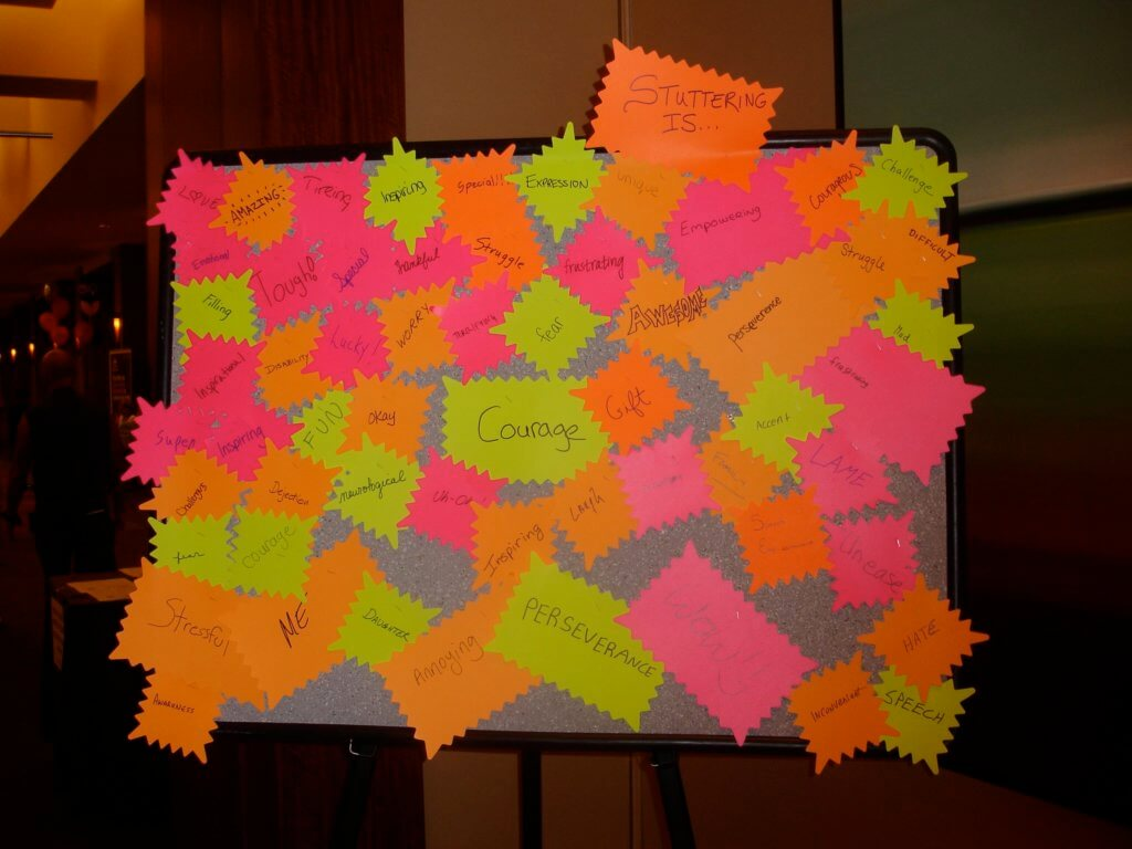 """Stuttering is"" board with post-its"