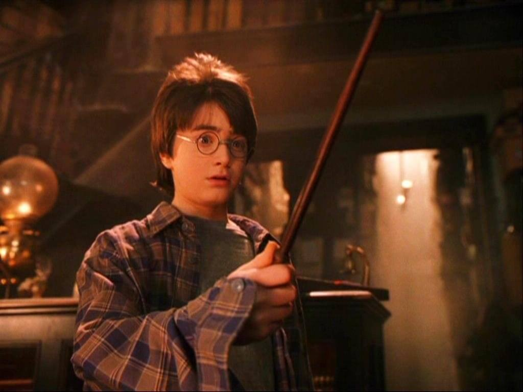 An image of Harry Potter with a wand from a Harry Potter film