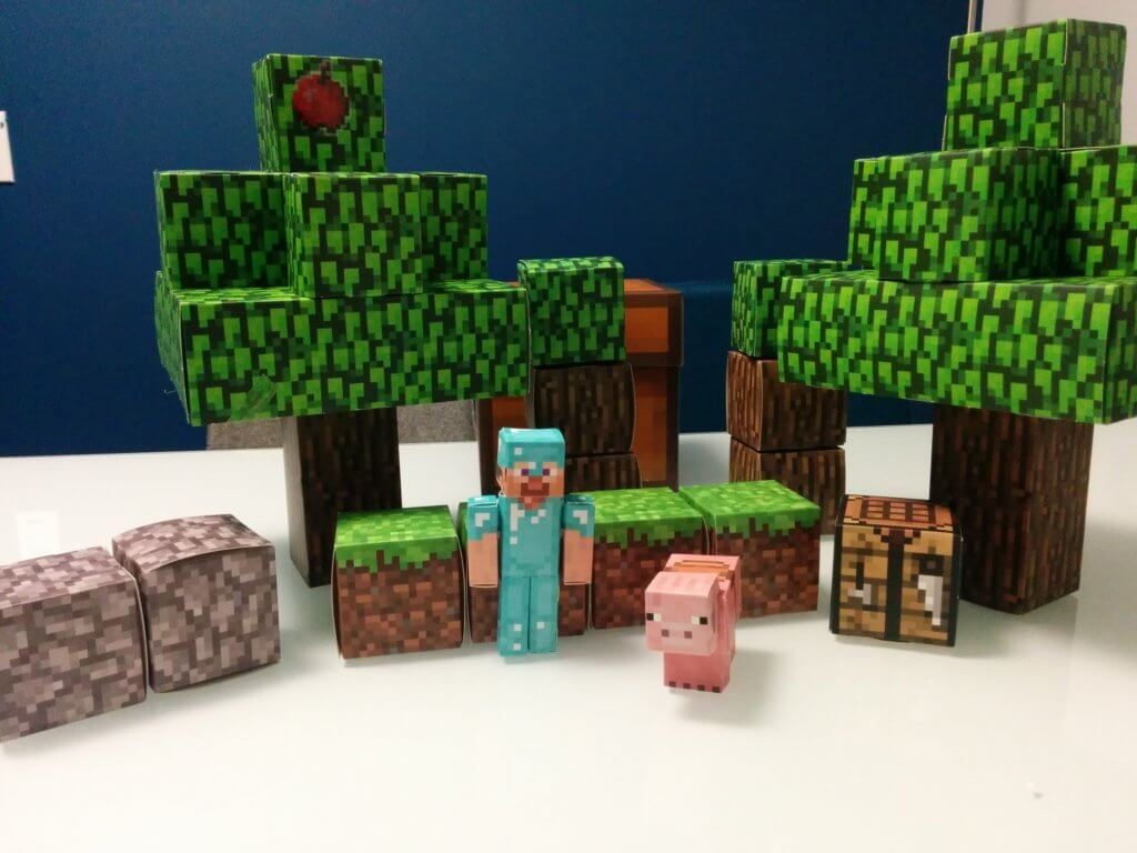 Image of papercraft Minecraft figures in the speech IRL office